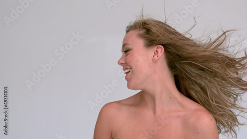 Attractive woman shaking her hair