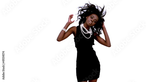 Woman in black dress dancing