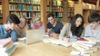 Group of students learning in a library