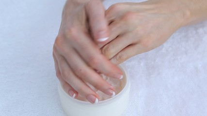 Woman moisturising hands