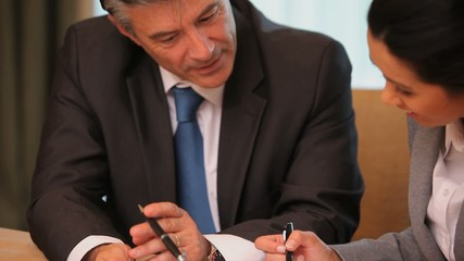Video of business people using tablet