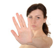 Hold on, Stop gesture showed by young woman hand isolated on whi