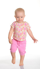 Funny baby girl running on white background