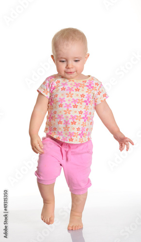 Funny baby girl running on white background