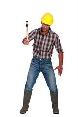 Labourer using a hammer