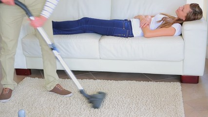 Woman napping while man doing the housework