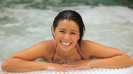 Laughing woman in a jacuzzi
