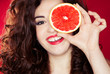 Portrait of pretty woman holding grapefruit