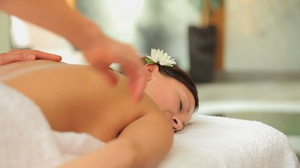 Woman being massaged carefully