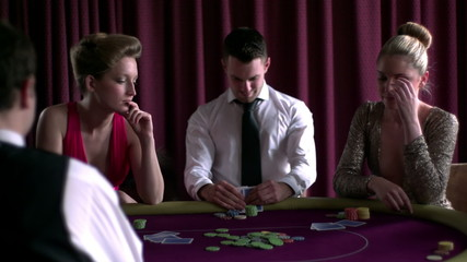 Man winning against two girl