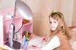 Cute little girl at her desk