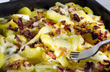 Dish of Tartiflette with fork