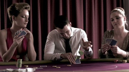 People betting and playing poker