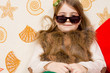 Young girl posing large sunglasses