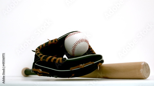 Baseball falling in baseball gloves