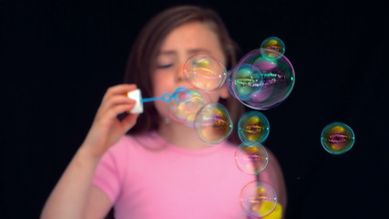 Girl making bubbles in slow motion