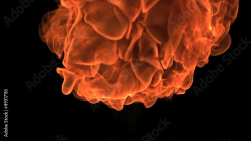 Fat fire ball moving in slowmotion vertically