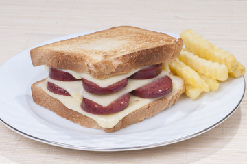 Sandwich with sausage and cheese