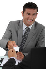 Man Handing Over His Business Card To A Potential Client Sticker