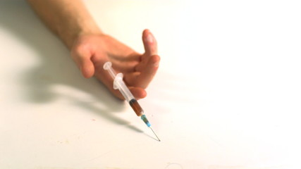 Hand dropping with a syringe