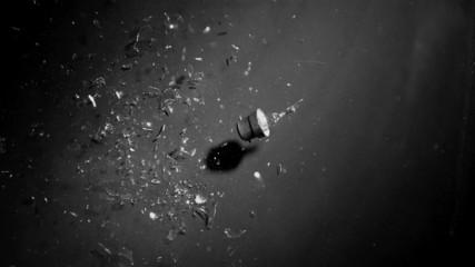 Bulb crushed on a black floor