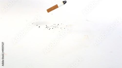 Cigarette filling on the floor on white background