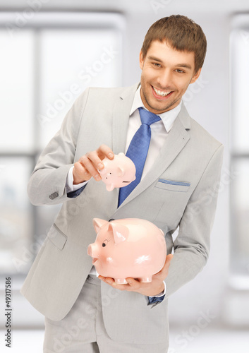man with two piggy banks