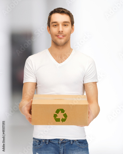handsome man with recyclable box