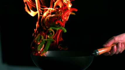 Peppers flaming in the pan