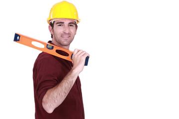 Tradesman carrying a spirit level