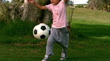Child playing football