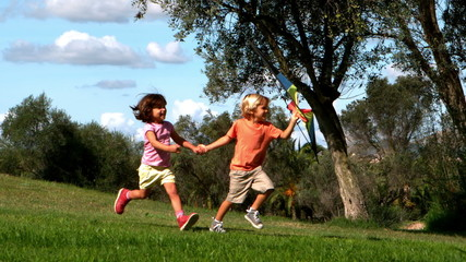 Two children playing with kite