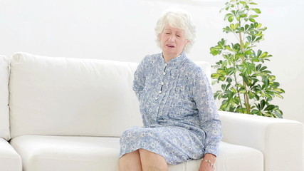 Old woman complaining of back pain