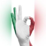 hand OK sign with Italian flag