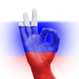 hand OK sign with Russian flag
