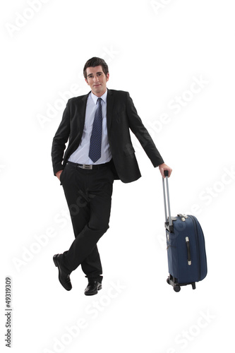Businessman with luggage stood waiting