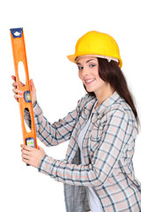 craftswoman holding a level
