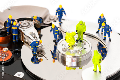 Group of engineers maintaining hard drive