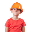 Girl in an orange helmet looking up