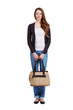 Girl in jeans standing and holding a bag