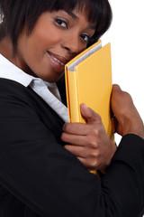 Businesswoman hugging a folder