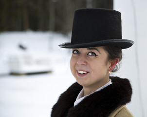 Cool portrait of young woman with hat