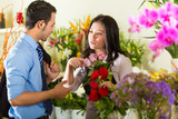 Saleswoman and customer in flower shop