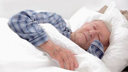 Elderly man asleep