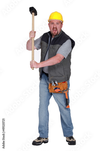 Angry construction worker with sledge-hammer