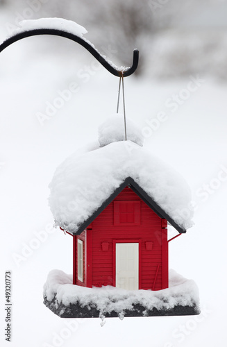 Snow Covered Red Bird House