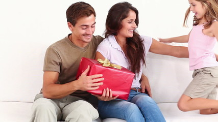 Mother and father getting gift from child
