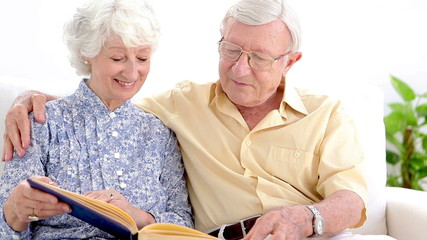 Old couple looking at photo album