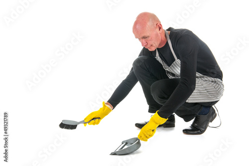 Houseman with dustpan and brush