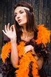 actress in brown and orange boa